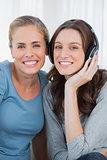Women posing while listening to music
