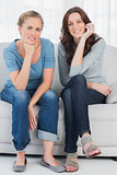 Relaxed women posing while sitting on the couch
