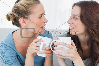 Friends talking while having coffee