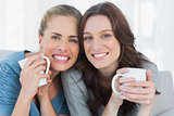 Smiling women holding their cup of coffee