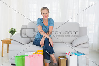 Blonde woman with shopping bags