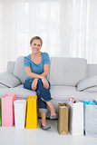 Cheerful blonde woman with shopping bags