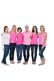 Smiling women posing with pink tops for breast cancer awareness