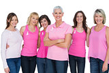 Enthusiastic women posing with pink tops for breast cancer