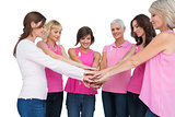 Cheerful women posing in circle wearing pink for breast cancer