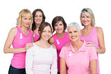 Happy women posing and wearing pink for breast cancer