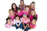Cheerful women looking up wearing pink for breast cancer