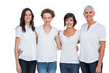 Cheerful women posing with white tops