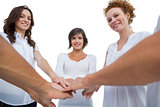 Cheerful models joining hands in a circle