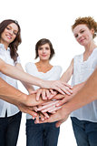 Peaceful women joining hands in a circle