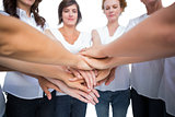 Relaxed women joining hands in a circle