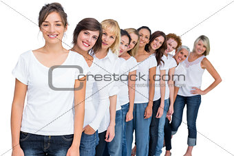 Casual models posing in a line looking at camera