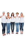 Cheerful casual models with thumbs up
