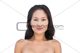Attractive nude brunette posing looking at camera