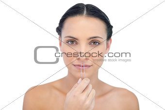 Calm young model with tweezers