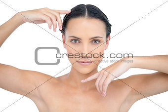 Attractive topless model gesturing