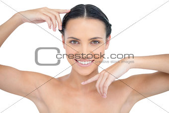 Smiling attractive topless model gesturing