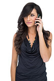 Brown haired model posing holding smartphone