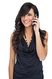 Smiling brown haired model posing holding smartphone