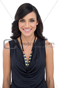 Smiling brown haired model with classy clothes posing