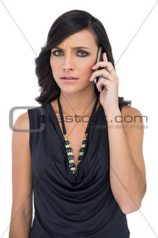 Anxious elegant brown haired model on the phone