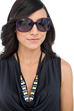 Elegant dark haired model wearing sunglasses