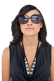 Serious elegant brunette wearing sunglasses