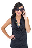 Cheerful elegant brunette on the phone wearing sunglasses