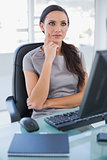Pensive businesswoman sitting on her swivel chair