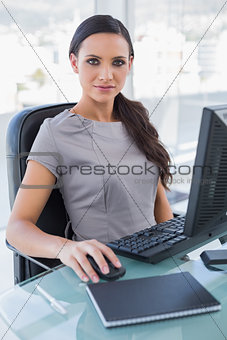 Attractive businesswoman working on her computer