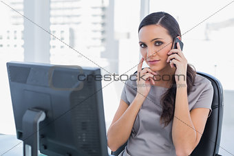 Annoyed attractive businesswoman having a phone conversation