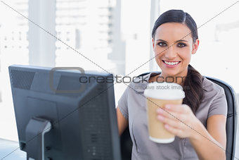 Attractive businesswoman offering coffee