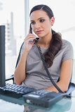 Thoughtful secretary answering land line