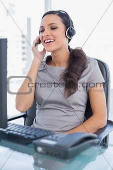 Smiling attractive secretary wearing headset