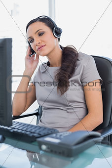 Relaxed attractive secretary wearing headset