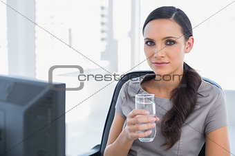 Attractive secretary holding water