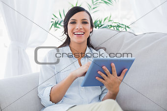 Smiling brunette with tablet pc