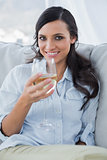 Cheerful attractive brunette drinking white wine
