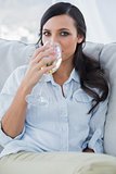 Attractive brunette drinking white wine