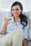 Seductive brunette drinking white wine