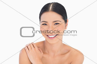 Portrait of smiling natural dark haired model