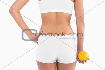 Back of female slender body in shorts