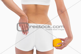 Toned female buttocks with white sport underwear