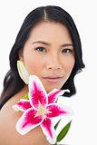 Sensual natural model posing with lily