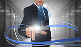 Businessman touching graph on futuristic interface with swirling lines
