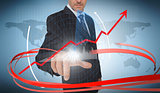 Businessman touching graph on futuristic interface with red arrow