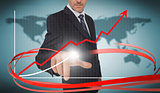 Businessman touching growth graph on futuristic interface with red arrow
