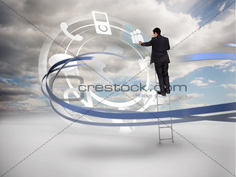Businessman on ladder touching wheel interface of applications