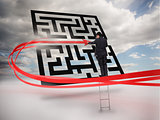 Businessman on ladder tracing red line through qr code