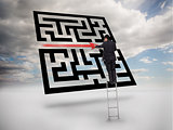 Businessman on ladder drawing red line through qr code